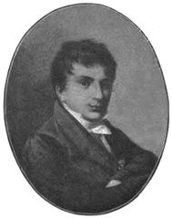 Bruno Kiciński. Stare owalne zdjęcie w szarości. Mężczyzna ubrany w surdut i białą koszulę. Włosy zaczesane na skronie i czoło.